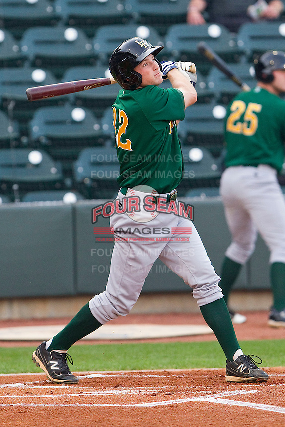 Phil Gosselin #22 of the Lynchburg Hillcats follows through on his swing against the Winston-Salem Dash at BB&T Ballpark on May 7, 2011 in Winston-Salem, North Carolina.   Photo by Brian Westerholt / Four Seam Images