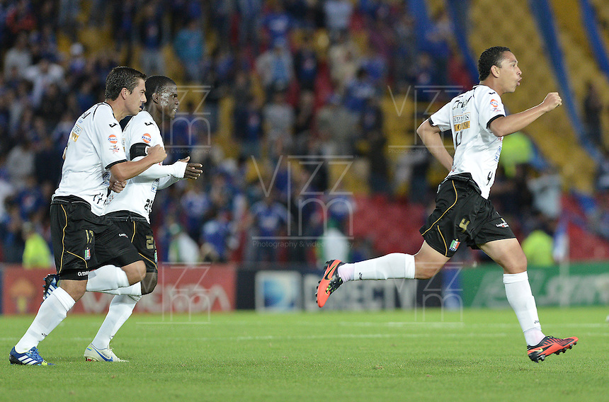 BOGOTÁ -COLOMBIA, 15-06-2013. Jugadores de Once Caldas celebran un gol en contra de Millonarios durante partido de los cuadrangulares finales F1 de la Liga Postobón 2013-1 jugado en el estadio el Campín de la ciudad de Bogotá./ Once Caldas' players celebrate a goal against Millonarios during match of the final quadrangular 1th date of Postobon  League 2013-1 at El Campin stadium in Bogotá city. Photo: VizzorImage/STR