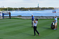 Adam Scott (AUS) watches his approach shot on 14 during round 2 Four-Ball of the 2017 President's Cup, Liberty National Golf Club, Jersey City, New Jersey, USA. 9/29/2017.<br /> Picture: Golffile | Ken Murray<br /> <br /> All photo usage must carry mandatory copyright credit (&copy; Golffile | Ken Murray)