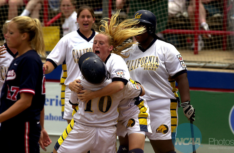 27 MAY 2002:  Chelsea Spencer of the University of California- Berkeley hugs Kaleo Eldredge (10) after she scored California's first run in the 7th inning against the University of Arizona's Jennie Finch (27) during the Division 1 Women's Softball Championship held at the    ASA Hall of Fame Stadium in Oklahoma City, OK.  Cal defeated Arizona 6-0 for the national title.  Bryan Terry/NCAA Photos