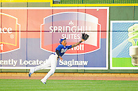 Great Lakes Loons center fielder James Baldwin (37) makes a diving attempt to catch a fly ball during the Midwest League game against the West Michigan Whitecaps at the Dow Diamond on June 11, 2013 in Midland, Michigan.  The Loons defeated the Whitecaps 13-6.  (Brian Westerholt/Four Seam Images)