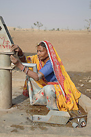 Sita, 55, is a Dalit (untouchable) woman who has been trained by the Barefoot College as a hand pump mechanic. Upper caste villagers formerly refused to use any wells that were touched by Dalits since they believed it made the water impure. But with the 8 year drought in Rajasthan villagers from all castes now depend on wells that are maintained by Sita...
