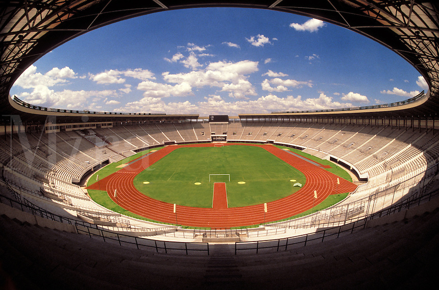 National sporting stadium built to the conventional model with running track, football field and other athletics facilities.  Harare, Zimbabwe.