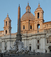 Piazza Navona at dawn showing Egyptian obelisk of the Fontana dei Quattro Fiumi (Fountain of the Four Rivers), 1651, Gian Lorenzo Bernini for Pope Innocent X, and 17th century Baroque church of Sant'Agnese in Agone, Rome, Italy. Picture by Manuel Cohen
