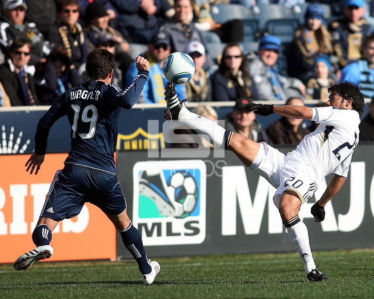 Carlos Ruiz#20 of the Philadelphia Union boots the ball past Blake Wagner#19 of the Vancouver Whitecaps during an MLS match at PPL Park in Chester, PA. on March 26 2011. Union won 1-0.