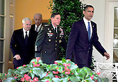 United States President Barack Obama, right, walks from the Oval Office to announce he is replacing General Stanley McChrystal, United States Army, Commander, International Security Assistance Force (ISAF) with General David H. Petraeus, Chief of the United States Central Command (CENTCOM), center right, Vice President Joseph Biden, center right, and U.S. Secretary of Defense Robert Gates, left, follow behind in Washington, D.C. on Wednesday, June 23, 2010..Credit: Ron Sachs / Pool via CNP