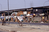 Sao Paulo, Brazil. Favela Vila Prudente shanty town; washing in front of rough wooden shacks.