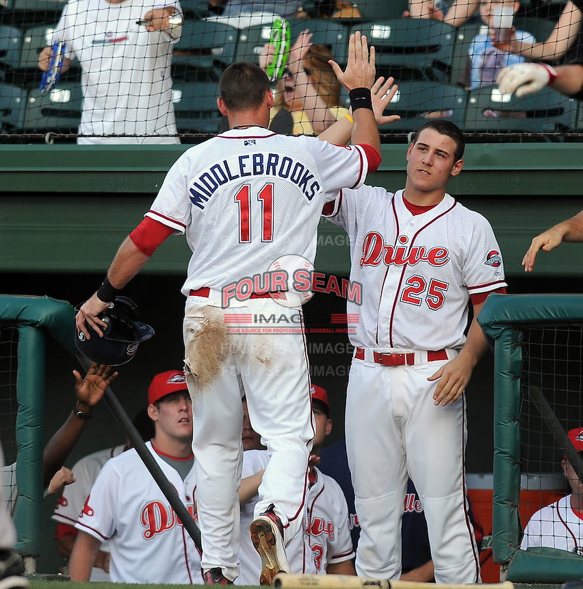 June 19, 2009: Anthony Rizzo (25), right, of the Greenville Drive congratulates Will Middlebrooks (11) after he scored a run in a game against the Lexington Legends at Fluor Field at the West End in Greenville, S.C. Photo by: Tom Priddy/Four Seam Images