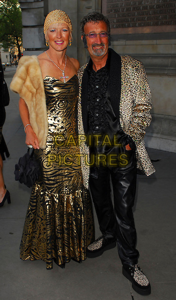 EDDIE JORDAN & WIFE.The Biba Ball at the Victoria & Albert Museum, London, UK..May 11th, 2006.Ref: CAN.full length gold black dress pattern animal print married husband.www.capitalpictures.com.sales@capitalpictures.com.©Capital Pictures