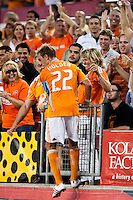Houston Dynamo midfielder Stuart Holden (22) celebrates his 47th minute goal with a hug from his mom.  Houston Dynamo defeated CD Chivas USA 1-0 at Robertson Stadium in Houston, TX on June 10, 2009.