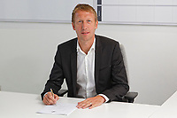 Pictured: Graham Potter signs his contract in his office. Monday 11 June 2018<br /> Re: Graham Potter is announced as the new manager for Swansea City AFC at the Fairwood Training Ground, south Wales, UK.