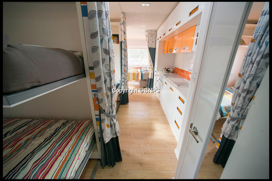 BNPS.co.uk (01202 558833)<br /> Pic: LauraDale/BNPS<br /> <br /> The view from the caravan's bathroom, with collapsable bunk beds on the left and two interior walls pushed forward to allow the beds to come down.<br /> <br /> A new mobile home that has movable walls to maximise the space the owner is using at the time is set to revolutionise the humble caravan holiday.<br /> <br /> The Concept Caravan measures 30ft by 13ft and uses the same area for different functions at different times.<br /> <br /> During the day, the movable bedroom wall is pushed back, freeing up an extra 60sq ft of room to create and impressive open-plan living space that has room for a 10 seater dining table.<br /> <br /> At night, the wall comes out and with it a foldaway bed to form a comfortable double bedroom.