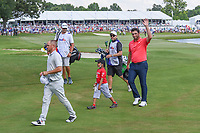 Jon Rahm (ESP) and Alex Noren (SWE) depart 18 with a young St. Jude patient following round 4 of the WGC FedEx St. Jude Invitational, TPC Southwind, Memphis, Tennessee, USA. 7/28/2019.<br /> Picture Ken Murray / Golffile.ie<br /> <br /> All photo usage must carry mandatory copyright credit (© Golffile | Ken Murray)