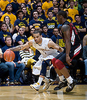 Justin Cobbs of California controls the ball away from Stanford during the game at Haas Paviliion in Berkeley, California on March 6th, 2013.  Stanford defeated California, 83-70.
