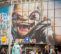 Activities in front of Toys R Us in busy Times Square in New York on Friday, March 27, 2015. Toys R Us announced ti will be leaving their 110,000 square foot Times Square store in 2016 when the lease expires. (© Richard B. Levine)
