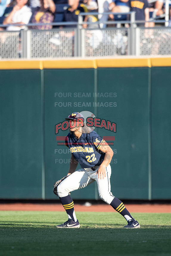 Michigan Wolverines outfielder Jordan Brewer (22) on defense against the Vanderbilt Commodores during Game 3 of the NCAA College World Series Finals on June 26, 2019 at TD Ameritrade Park in Omaha, Nebraska. Vanderbilt defeated Michigan 8-2 to win the National Championship. (Andrew Woolley/Four Seam Images)