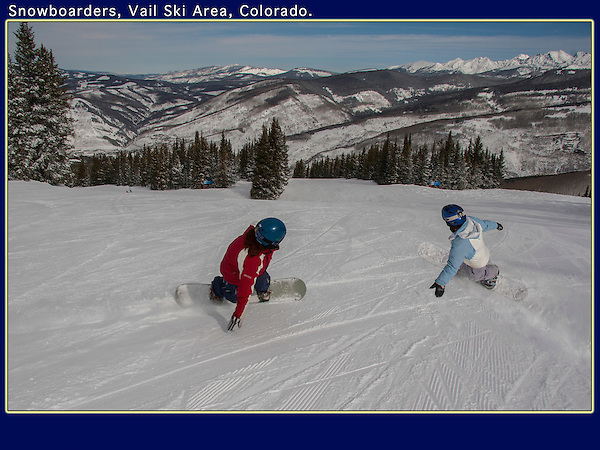 Young women snowboarding in Blue Sky Basin at Vail Ski Area, Colorado. <br />