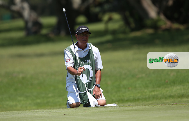 Pete (the Pro) Futcher looks at the line of putt for Damien McGrane (IRL) during Round Three of The Africa Open 2014 at the East London Golf Club, Eastern Cape, South Africa. Picture:  David Lloyd / www.golffile.ie
