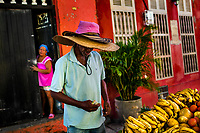 A Colombian vendor sells fruits in front of a colonial house in Getsemaní, a popular artistic neighborhood in Cartagena, Colombia, 16 December 2017. With the peace agreement, ending a 52-year civil conflict and promising political stability, together with rapid economic growth and unexploited tourism potential, Colombia has truly become a holiday destination. Cartagena, a UNESCO World Heritage site on the tropical Caribbean coast, plays the primary role in Colombia's tourism renaissance. The historic sites from the Spanish colonial times are being restored, private investments are visible throughout the city and an increased number of local people benefit from the boom of the travel related services.