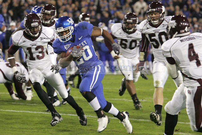 Kentucky running back Derrick Locke avoids Mississippi State defense in the first half of the game at Commonwealth Stadium Saturday night. .Photo by Zach Brake | Staff