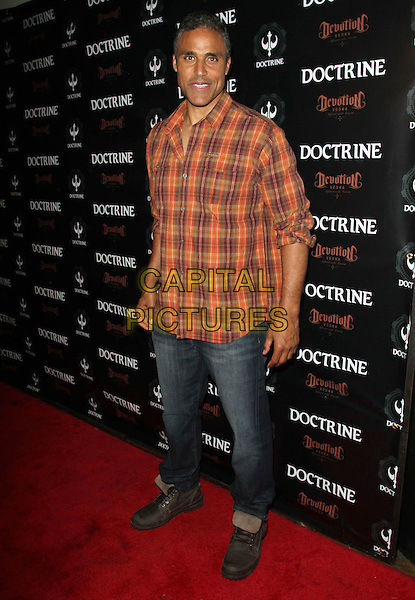 RICK FOX .Doctrine Clothing and Devotion Vodka Launch held at Sky Bar at Boudoir, West Hollywood, CA, USA, .12th October 2010..full length red orange plaid shirt jeans .CAP/ADM/KB.©Kevan Brooks/AdMedia/Capital Pictures.