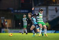 Matt Butcher of Yeovil Town holds back Dominic Gape of Wycombe Wanderers during the Sky Bet League 2 match between Wycombe Wanderers and Yeovil Town at Adams Park, High Wycombe, England on 14 January 2017. Photo by Andy Rowland / PRiME Media Images.