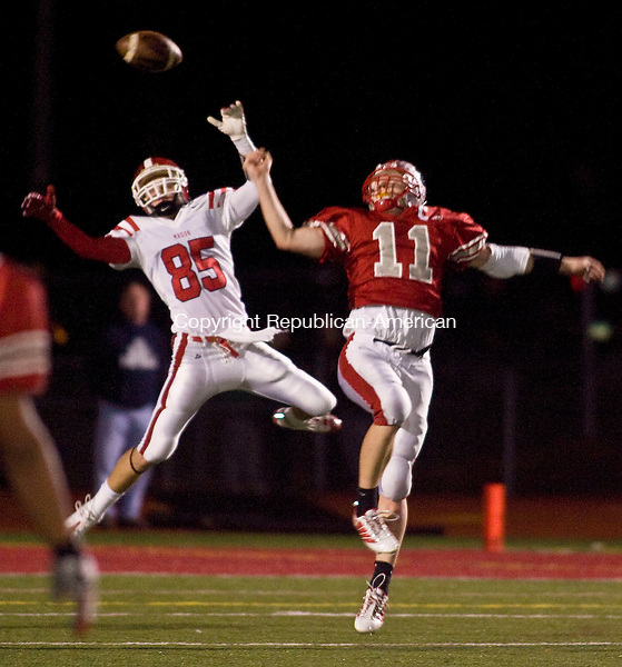 SOUTHBURY, CT - 19 NOVEMBER 2009 -111909JT07-<br /> Pomperaug's Andrew Clements breaks up a pass intended for Masuk's Anthony Giamo during Thursday's Southwest Conference Football Championship at Pomperaug.<br /> Josalee Thrift Republican-American