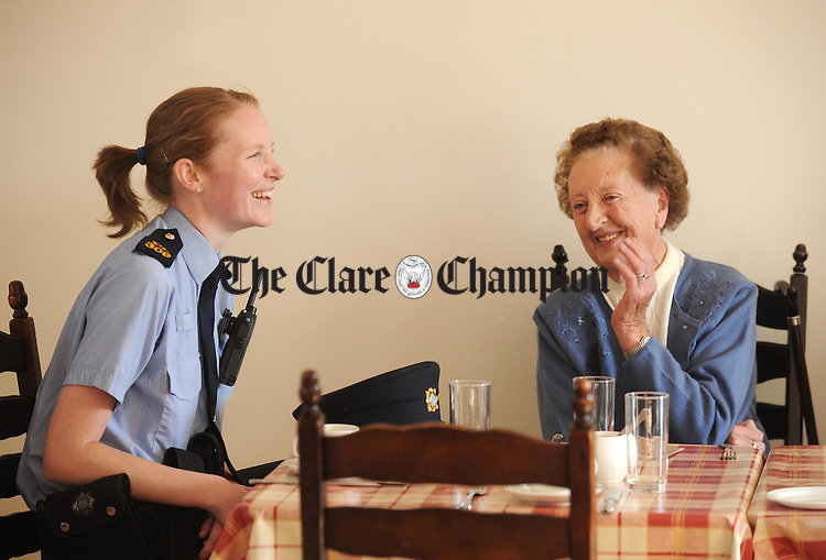 Garda Noreen Molineaux shares a joke with Lily Conroy from Carron during a talk on crime prevention and security at Ennistymon Day Centre. Photograph by Declan Monaghan