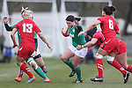 Wales centre Gemma Rowland tackles her opposite number Jackie Shiels.<br /> 6 Nations Championship<br /> Wales v Ireland Women<br /> St Helens Swansea<br /> 15.03.15<br /> &copy;Steve Pope - SPORTINGWALES
