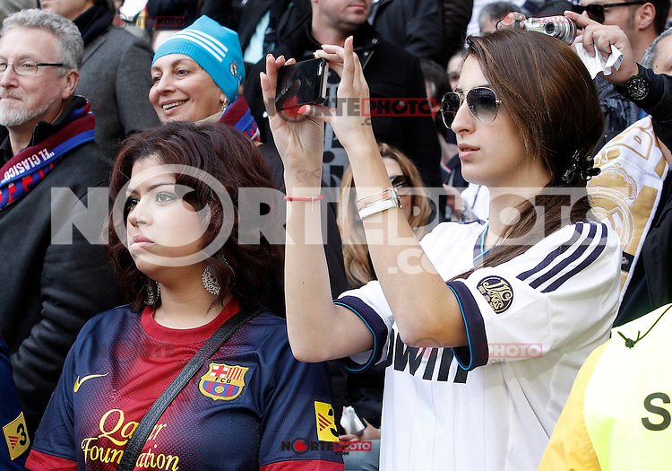 Real Madrid's supporter (r) and FC Barcelona's supporter during La Liga match.March 02,2013. (ALTERPHOTOS/Acero) /NortePhoto