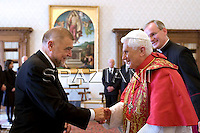 Pope Benedict XVI listens to Croatian president Stjepan Mesic during a private audience at the Vatican on November 12, 2009.