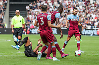 Riyad Mahrez of Manchester City is fouled and referee Mike Dean awards a penalty during the Premier League match between West Ham United and Manchester City at the London Stadium, London, England on 10 August 2019. Photo by David Horn.