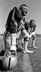 Oakland Raiders training camp August 10, 1982 at El Rancho Tropicana, Santa Rosa, California.   Oakland Raiders linebacker John Matuszak (72) and linebacker Ted Hendricks (83).