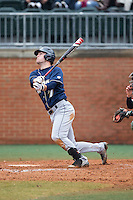 Kris Simonton (7) of the Akron Zips follows through on his swing against the Charlotte 49ers at Hayes Stadium on February 22, 2015 in Charlotte, North Carolina.  The Zips defeated the 49ers 5-4.  (Brian Westerholt/Four Seam Images)