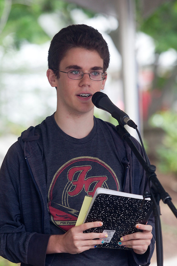 "Jaden Lindsey, an 8th grader at the Vancouver School of Arts & Academics recites a poem near Esther Short Park in downtown Vancouver July 3, 2016. Lindsey's poem was selected to be featured in the C-Trans program, ""Poetry Moves"" and will displayed in busses. (Photo by Natalie Behring/ The Columbian)"