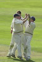 Photo Peter Spurrier.01/09/2002.Village Cricket Final - Lords.Elvaston C.C. vs Shipton-Under-Wychwood C.C..Elvaston's  James bodill (left) is congratulated by team mates after running out Shipton's Phil Garner.