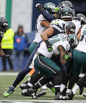 Seattle Seahawks outside linebacker K.J. Wright (50) holds Philadelphia Eagles running back Ryan Mathews (24) for a one-yard gain at CenturyLink Field in Seattle, Washington on November 20, 2016.  Seahawks beat the Eagles 26-15.  ©2016. Jim Bryant Photo. All Rights Reserved.