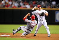 Sept. 12, 2008; Phoenix, AZ, USA; Arizona Diamondbacks shortstop Stephen Drew throws to first base to complete the double play after forcing out Cincinnati Reds base runner (21) Chris Dickerson at Chase Field. Mandatory Credit: Mark J. Rebilas-