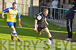 Dingle Bay Rovers Seamus Begley gets away from Classic FC's Daniel Clinton in the FAI junior cup at Mounthawk park, Tralee on Sunday.