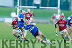 Cian Hussey of St Brendans slips in possession as Causeway's Keith Carmody and Joseph Diggins are about to pounce, in the Division 1 County Hurling League final