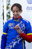 03 NOV 2012 - IPSWICH, GBR - Helen Wyman (GBR) of Great Britain looks at her medal after winning the Elite Women's European Cyclo-Cross Championships in Chantry Park, Ipswich, Suffolk, Great Britain (PHOTO (C) 2012 NIGEL FARROW)
