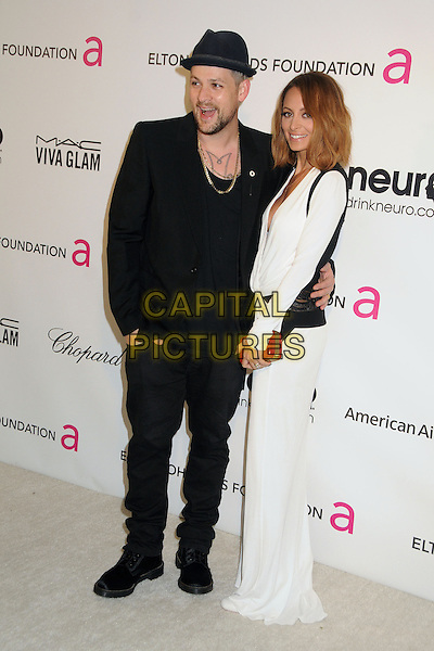 Joel Madden and Nicole Richie Madden.21st Annual Elton John Academy Awards Viewing Party held at West Hollywood Park, West Hollywood, California, USA..February 24th, 2013.oscars full length  black suit hat beard facial hair white dress long sleeves side  red clutch bag married husband wife.CAP/ADM/BP.©Byron Purvis/AdMedia/Capital Pictures.
