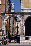 Street Scene in Verona, Italy, Europe featuring Arch and Statue above Street Cafe