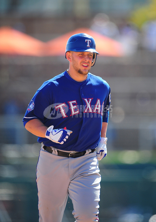 Mar. 16, 2012; Phoenix, AZ, USA; Texas Rangers batter Brandon Snyder rounds the bases after hitting a solo home run in the fifth inning against the  Los Angeles Dodgers at The Ballpark at Camelback Ranch. Mandatory Credit: Mark J. Rebilas-