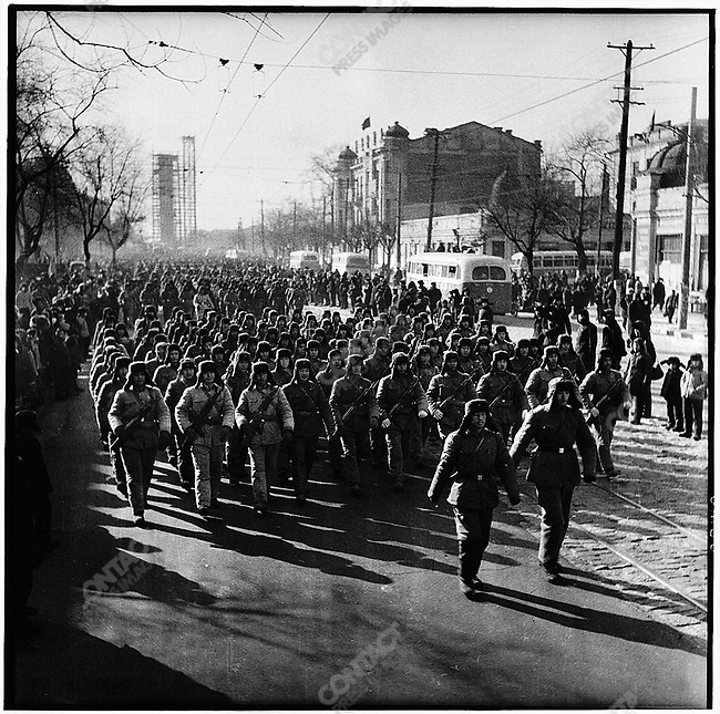 Three days after the founding of Heilongjiang's revolutionary committee, PLA soldiers march in support of the rebel groups and the seizure of power from the provincial government. Harbin, 2 February 1967