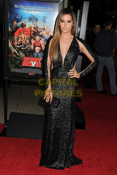 "Ashley Tisdale.Attending the ""Scary Movie 5"" Los Angeles film premiere held at the Cinerama Dome,  Hollywood, California, USA, .11th April 2013..full length dress sleeves cut out sheer see thru through black sequined sequin low cut ombre hair dyed clutch bag sleeves long maxi hand on hip .CAP/ADM/BP.©Byron Purvis/AdMedia/Capital Pictures"