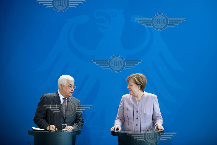 Mahmoud Abbas, Palestinian President, and Chancellor Angela Merkel during a press conference during Abbas' visit to the Chancellery.