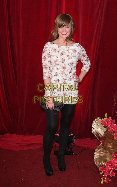 KIRSTY LEIGH PORTER .British Soap Awards 2010 at the London ITV Studios, South Bank, London, England..May 8th 2010.arrivals full length black tights leggings clutch bag white top dress pink floral print hand on hip.CAP/ROS.©Steve Ross/Capital Pictures.