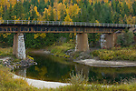 Union Pacific Railroad bridge over the Pack River with reflections and autumn colors, Sandpoint, Idaho.