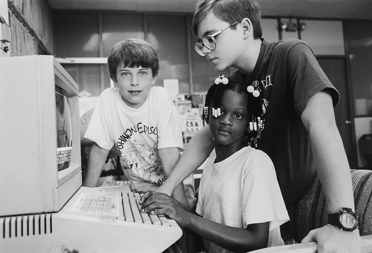 John Selby (9), Kimberly Colley (7) and Assistant to computer instructor Nicolai Tolstoy (13) at Washington Episcopal School in Bethesda, Maryland. Nicolai is teaching the younger kids how to work LEGO TC logo after making a LEGO project you can then operate it electronically via the computer, on July 11, 1994. (Photo by Maureen Keating/CQ Roll Call via Getty Images)